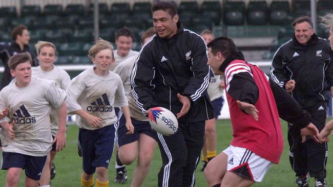 All Black Dylan Mika having some fun with schoolkids during training in 1999.