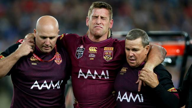 QLD's Brent Tate helped off injured during Game 2 of the 2014 State of Origin series at ANZ Stadium. Picture: Gregg Porteous
