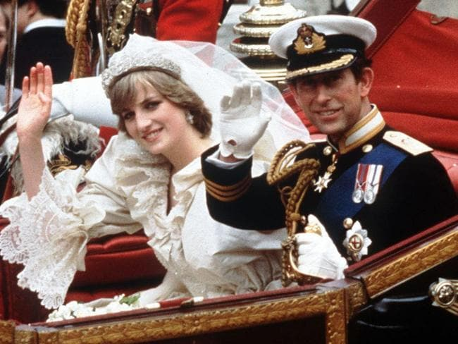The Princess and Prince of Wales wave from their carriage on their wedding day in 1981.