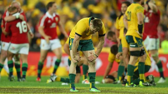 James O?Connor of the Wallabies looks dejected as the Lions celebrate victory at the final whistle. Picture: Getty
