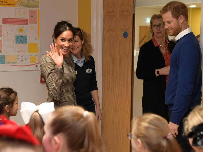 Britain's Prince Harry and his fiancée US actress Meghan Markle say goodbye after visiting a street dance class in Cardiff, south Wales. Picture: AFP