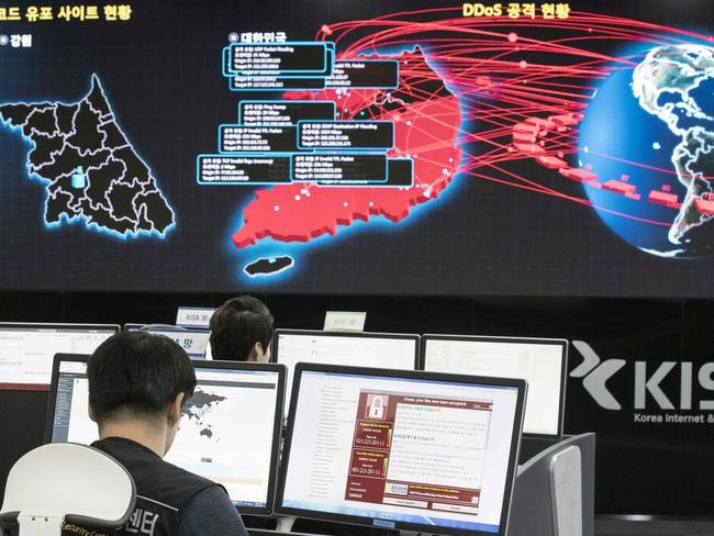 Staff monitor the spread of ransomware cyberattacks at the Korea Internet and Security Agency in Seoul on May 15. Picture: Getty