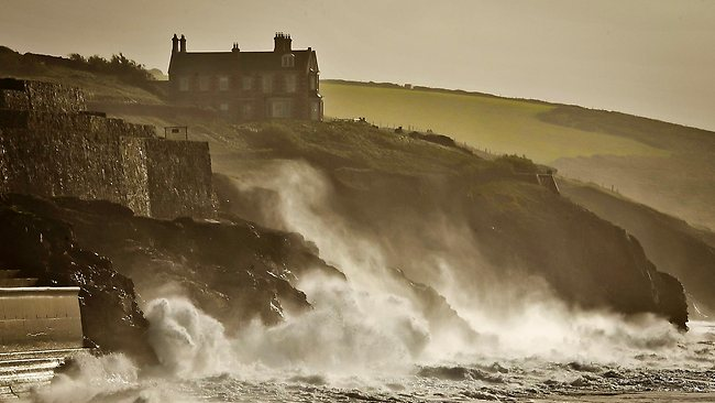 Waves crash onto the cliffs surrounding Porthleven, Cornwall, southwest England. Forecasters say a severe storm will hit the southern half of Britain, bringing heavy rains and wind gusts up to 130km/h.