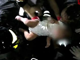"This image grab from a video released by Italy's Vigili del Fuoco (firemen) shows the rescue of a baby by Italian firemen after an earthquake hit the popular Italian tourist island of Ischia, off the coast of Naples, causing several buildings to collapse on August 21, 2017. A magnitude-4.0 earthquake struck the Italian holiday island of Ischia, causing destruction that left two people dead at peak tourist season, authorities said, as rescue workers struggled early Tuesday to free two children from the rubble. / AFP PHOTO / Vigili del Fuoco / Handout / RESTRICTED TO EDITORIAL USE - MANDATORY CREDIT ""AFP PHOTO / HO / VIGILI DEL FUOCO"" - NO MARKETING NO ADVERTISING CAMPAIGNS - DISTRIBUTED AS A SERVICE TO CLIENTS"