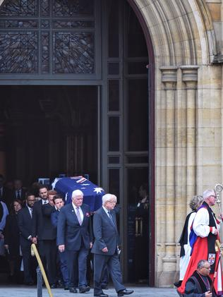 Lou Richards' coffin leaves the Cathedral. Picture: Tony Gough