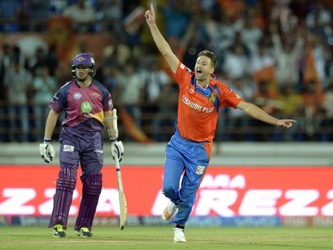 Andrew Tye (R) celebrates one of his five wickets.