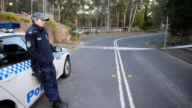 Police closed Henry Lawson Drive after a body was found burned beyond recognition at Picnic Point. Picture: John Grainger.