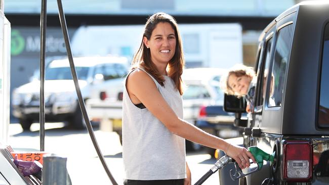 Jess Walker and son Lachlan are always on the lookout for cheap fuel. Picture: Brett Costello