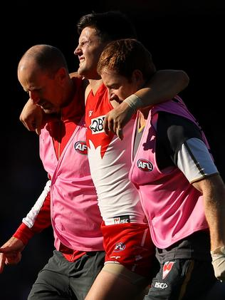 Nic Newman is carried from the field. Picture: Getty Images