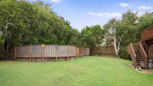 The 1980s house has a large backyard with a dated above-ground pool out the back.