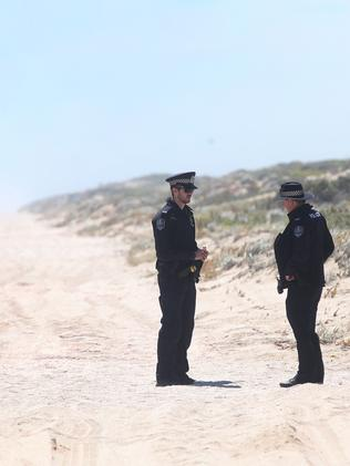 Police examine the scene where two female backpackers were allegedly kidnapped and assaulted near Tea Tree Point in the Coorong. Photo: Calum Robertson