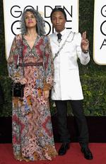 Pharrell Williams and Helen Lasichanh attend the 74th Annual Golden Globe Awards at The Beverly Hilton Hotel on January 8, 2017 in Beverly Hills, California. Picture: AFP