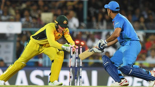 Australias's wicketkeeper Tim Paine stumps India's Mahendra Singh Dhoni off the bowling of Adam Zampa.