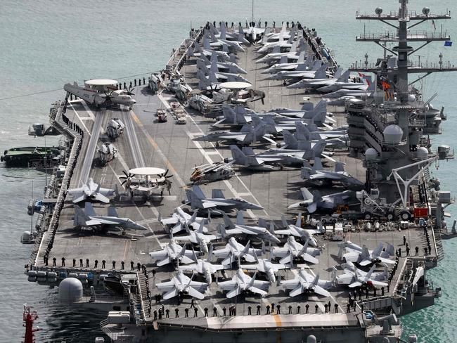 The USS Ronald Reagan aircraft carrier arrives in the South Korean port city of Busan. US military dominance has diminished significantly in recent years, a report has found. Picture: AFP