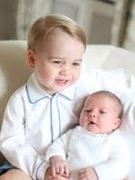 Prince George holds his baby sister, Britain's Princess Charlotte. Picture: AP