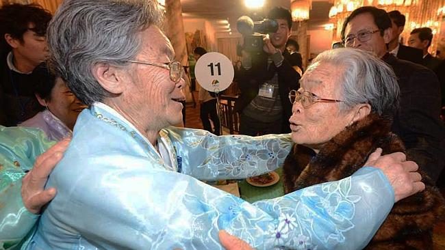 Back together ... South Korean Kim Sung-Yoon (R), 96, meets with her North Korean sister during a family reunion after being separated for 60 years.