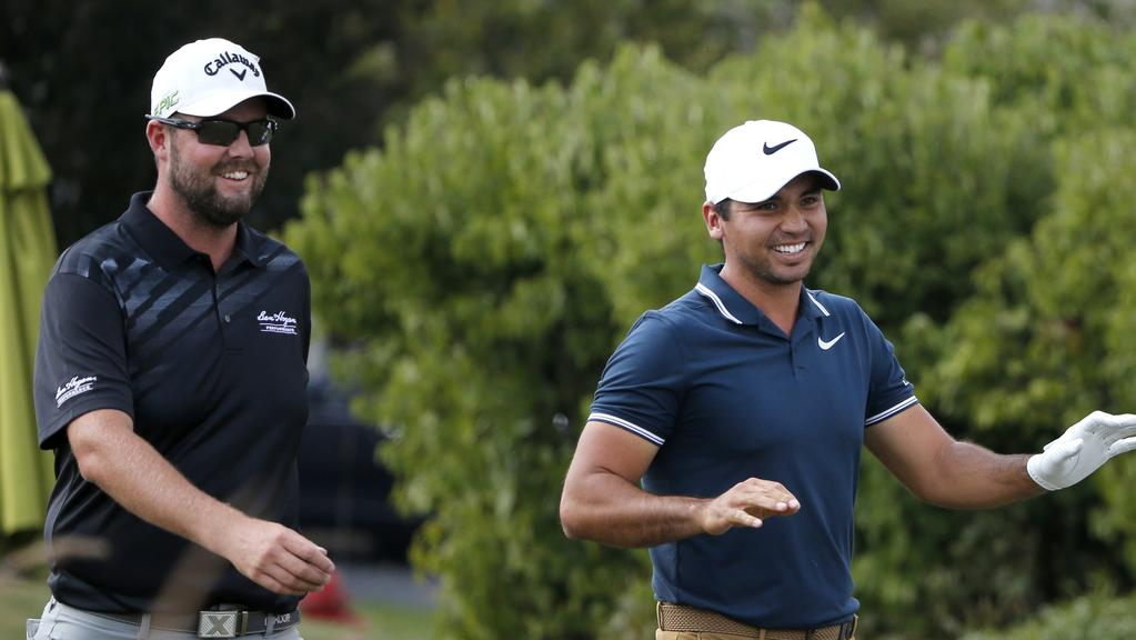 Marc Leishman, left, and Jason Day during the third round of the BMW Championship.