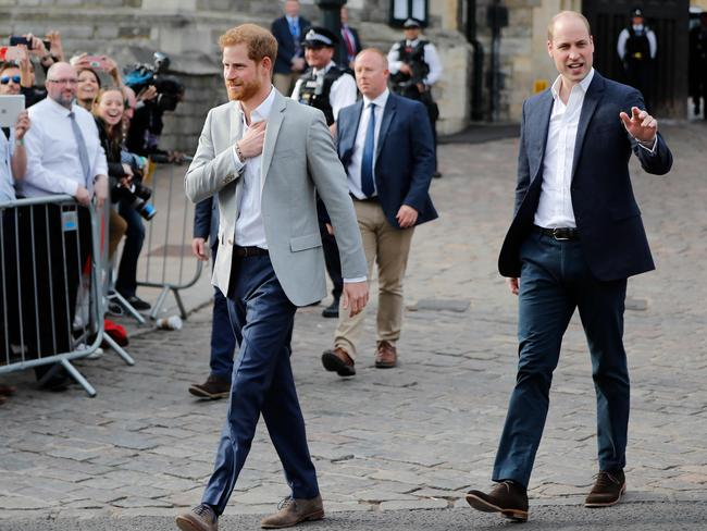 Britain's Prince Harry (L) and his best man Prince William, Duke of Cambridge, (R) greet well-wishers on the street outside Windor Castle in Windsor. Picture: AFP