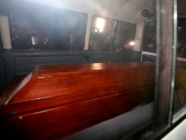 Grim ... The coffin carrying Andrew Chan in the back of an ambulance at Cilacap. Pic: Adam Taylor