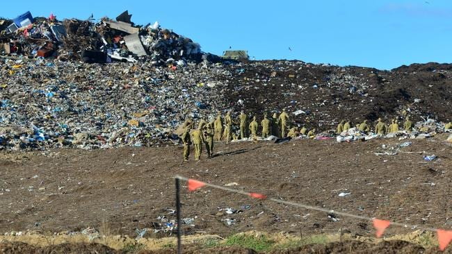 Soldiers at the Hervey Range landfill and waste transfer facility at Bohle Plains.