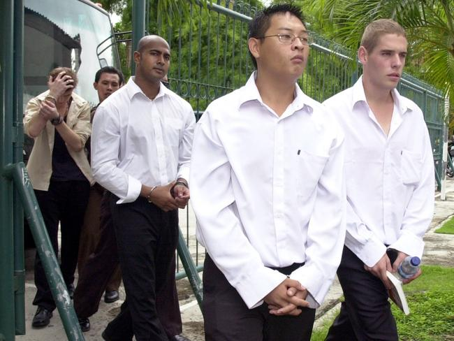Myuran Sukumaran, Andrew Chan, and Michael Czugaj arrive at Denpasar court. Picture: Firdia Lisnawati.