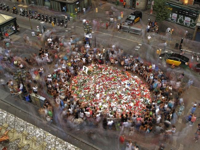 The site of the attack has become a memorial as people pay tribute with flowers, messages and candles along Barcelona's historic Las Ramblas promenade. Picture: Manu Fernandez/AP Photo