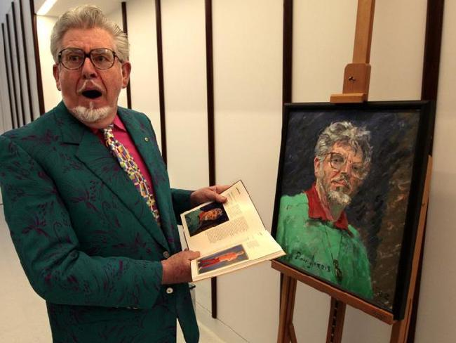 Losing everything ... Rolf Harris with his self portrait at the National Portrait Gallery in 2008, the portrait gallery has since removed the painting from view. Picture: Ray Strange