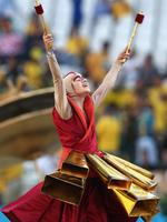 SAO PAULO, BRAZIL - JUNE 12: An artist performs during the Opening Ceremony of the 2014 FIFA World Cup Brazil prior to the Group A match between Brazil and Croatia at Arena de Sao Paulo on June 12, 2014 in Sao Paulo, Brazil. (Photo by Adam Pretty/Getty Images)