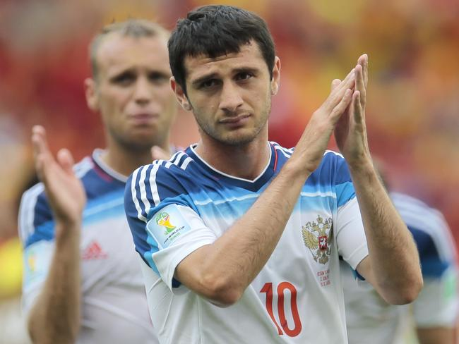 Russia's Alan Dzagoev applauds the crowd after the group H World Cup soccer match between Belgium and Russia.