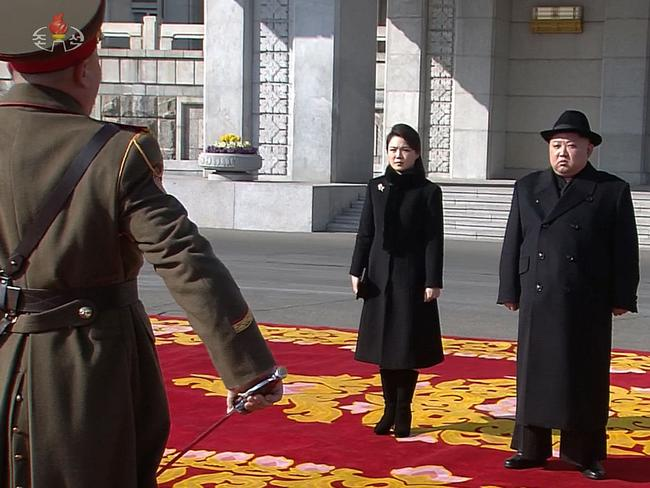 Kim and his wife Ri Sol-ju pictured attending the parade in Pyongyang. Picture: AFP/KCNA