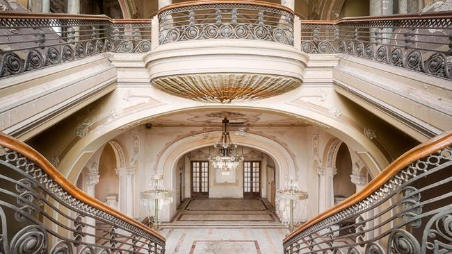 The grand staircase in the abandoned casino that is now home to cats and pigeons. Picture: Roman Robroek/Cater News.
