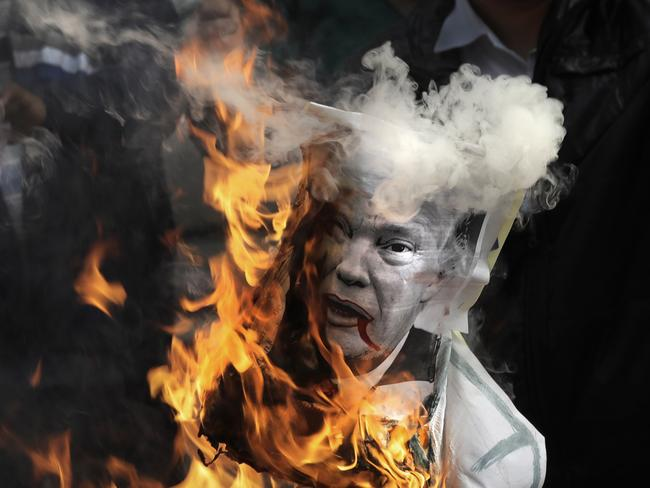 Activists burn an effigy of U.S. President Donald Trump during a protest against his recognition of Jerusalem as Israel's capital in India. Picture: AP