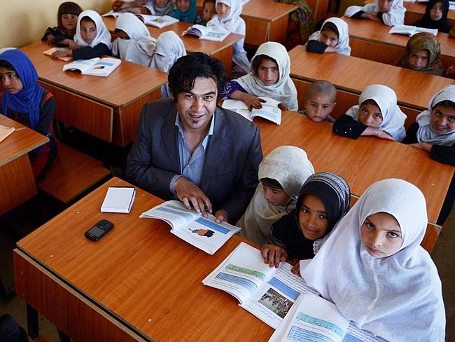 Civilian casualty ... reporter Sardar Ahmad, seen here in 2013 with Afghan schoolgirls north of Kabul, was gunned down March 20, 2014, when four gunmen attacked the Serena hotel in Kabul. Picture: Joris Fioriti