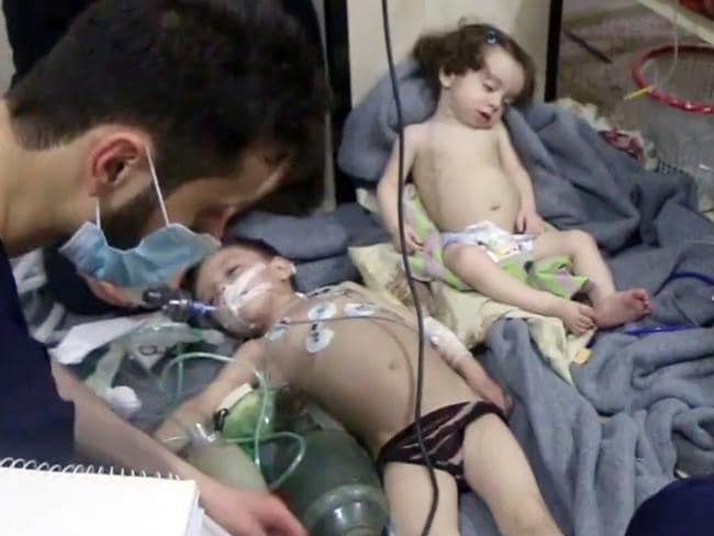 Video from the Syrian Civil Defense White Helmets, shows medical workers treating toddlers following an alleged poison gas attack in the opposition-held town of Douma, in eastern Ghouta, near Damascus, Syria. Picture: Syrian Civil Defense White Helmets via AP, File.