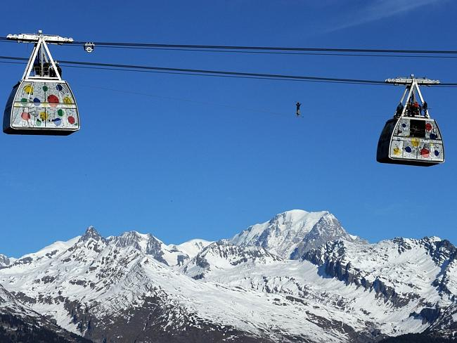 Julien Millot walked 60m between two 380m high gondolas. Picture: AFP