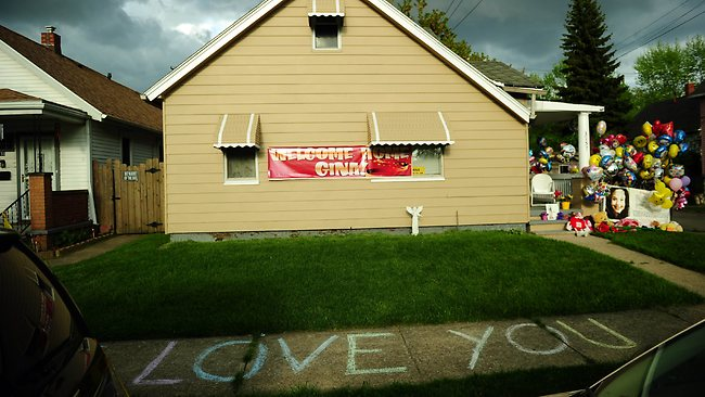 The family house of Gina DeJesus, one of the three women which were held captive for a decade, stands decorated by well wishers May 7, 2013 in Cleveland, Ohio. AFP PHOTO/Emmanuel Dunand