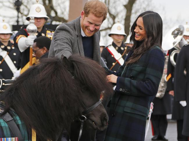Prince Harry and his fiancee Meghan Markle meet a Shetland Pony as they arrive at Edinburgh Castle. Picture: AP/Frank Augstein