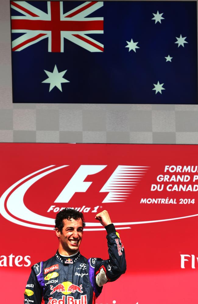 The Australian flag takes pride of place above the podium.