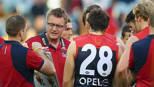Demons coach Mark Neeld talks to his players at quarter-time. Picture: Getty