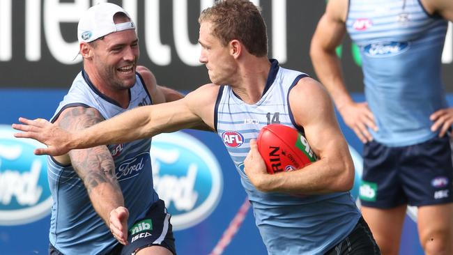 Former Cat Josh Hunt and Joel Selwood have a laugh at Geelong training.