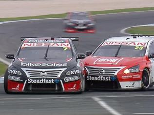 Todd Kelly and Michael Caruso clash with three laps to go in Supercars Race 6 at the WD-40 Phillip Island 500. Pic: FOX SPORTS.