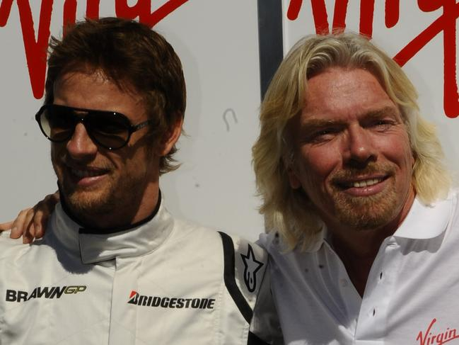 Formula 1 Grand Prix at Albert Park. Richard Branson with Brawn drivers Jenson Button and Rubens Barichello