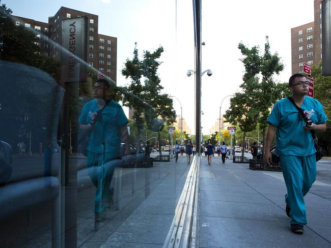 Tests ... A medical worker walks past Mount Sinai Hospital in New York City, where Doctors are testing a man for Ebola. Picture: AFP