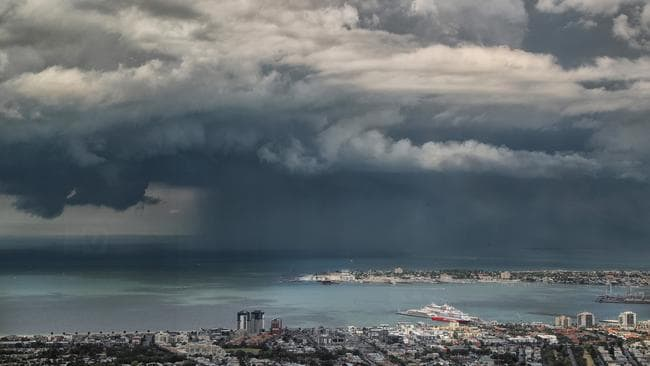 A tropical storm over bayside Melbourne, as seen from the Eureka Skydeck. Picture: Alex Coppel