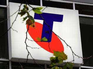 A Telstra logo is seen through a tree branch with only a few leaves on it in Sydney, Australia, Thursday, Aug. 11, 2011. Telstra Corp., Australia's largest telecommunications company, reported a 17 percent fall in annual profit to 3.2 billion Australian dollars (US$3.3 billion). (AP Photo/Rick Rycroft)