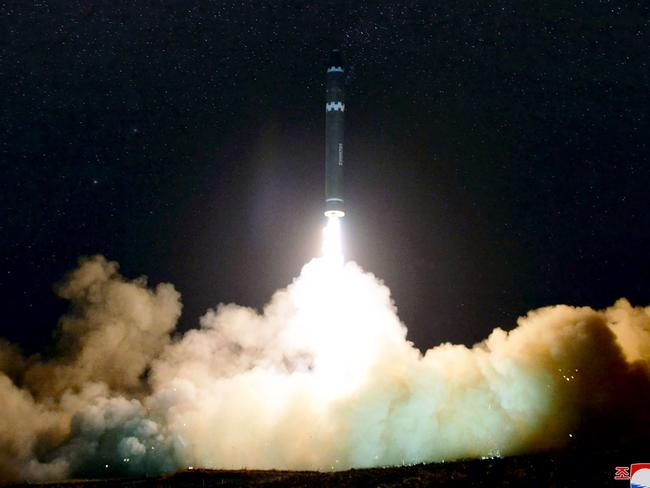 Pictures capture the moment the Hwasong-15 missile blasts off. Picture: KNCA/AFP