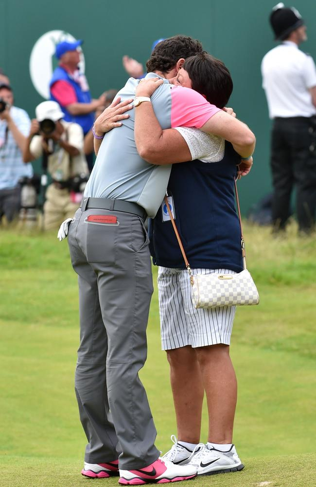 Northern Ireland's Rory McIlroy (L) embraces his mother Rosie after the win.