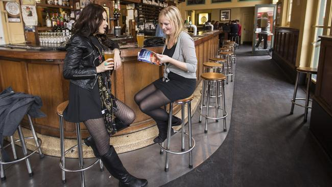 Overseas visitors enjoy a beer at The Exeter hotel.