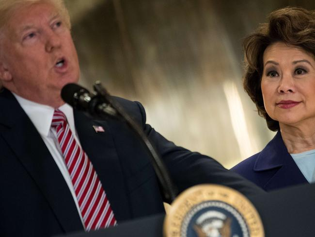 Transportation Secretary Elaine Chao (R), the wife of Mitch McConnell, looks on as President Donald Trump makes more comments about Charlottesville. Picture: Getty