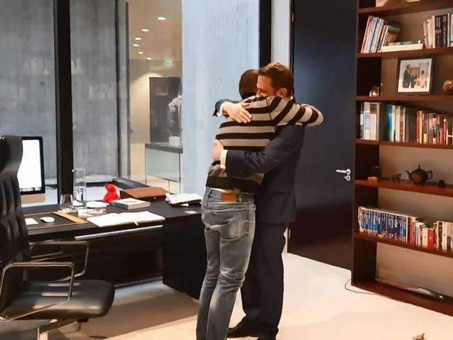 Brendan Berne and Thomas Marti embrace after the proposal. Picture: Facebook
